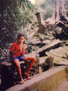Boy with a flute in the forest near Ta Prohm, Siem Reap, Cambodia
